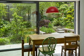View from inside conservatory to shady courtyard garden outside