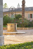 Stone well in mediterranean courtyard