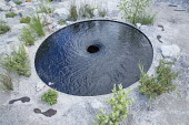 Circular vortex pool, footprint sculptures
