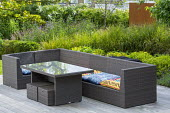 Contemporary sofa and table on decking, Anemanthele lessoniana syn. Stipa arundinacea