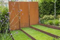 Grass steps with cor-ten steel risers, cor-ten steel wall, Verbena bonariensis, euphorbia