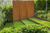 Grass steps with cor-ten steel risers, cor-ten steel wall, yew hedge, Verbena bonariensis, euphorbia
