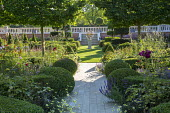 Stone path, clipped box domes, armillary sphere, pleached hornbeam screen