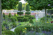 Path through formal box parterre, armillary sphere, yew topiary, Argyranthemum 'Cornish Gold'