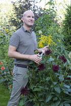 Graham Lloyd-Brunt cutting dahlia flowerhead