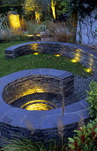 Lit spiral stone wall, built-in benches