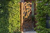 Cor-Ten steel gate, hornbeam hedges