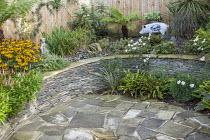 Stone raised bed, Rudbeckia fulgida var. sullivantii 'Goldsturm', Persicaria affinis 'Darjeeling Red', Asplenium scolopendrium, Astelia nervosa 'Westland'