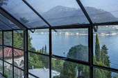 View from inside conservatory across Lake Como