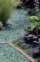 Stone-edged glass mulch path