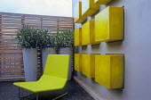 London balcony garden, yellow chair, tall containers