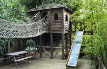 Play area, rope bridge walkway, slide, bamboo
