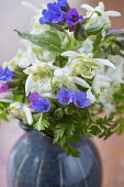 Posy of snowdrops and pulmonaria in ceramic vase