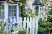 White painted picket fence around front garden, colourful bunting flag decorations