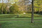 Box parterre, stone statue, white bench, yew hedges