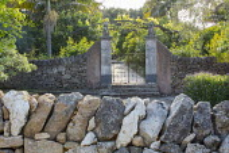 Metal gates in stone wall