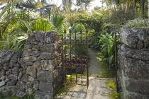 Metal gate in stone wall