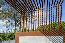 Metal pergola screen over contemporary roof terrace, Quercus suber