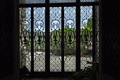 View from inside through decorative screen to courtyard outside
