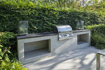 Outdoor kitchen, cooking range, grill and worktop, glass lanterns