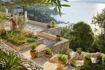 View across stone mediterranean terrace, terracotta pots