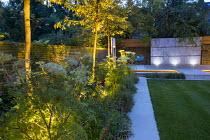 Mowing strip, Selinum wallichianum, uplit Amelanchier 'Robin Hill', Erigeron karvinskianus, zinc coated galvanised steel wall panel