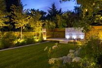 Mowing strip around rectangular lawn, row of uplit Amelanchier 'Robin Hill', zinc coated galvanised steel wall panel, Selenium wallichianum