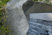 Large rock by dry-stone wall