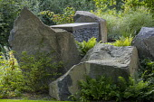 Large rocks, dry-stone built-in wall bench