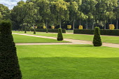 Wide gravel paths, yew topiary in formal lawns