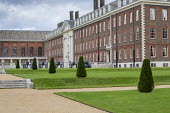 Wide gravel paths, stone steps, row of yew topiary in formal lawns in front of Royal Hospital, cannons