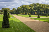 Wide gravel path, yew topiary in formal lawns