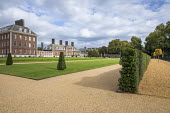 Wide gravel paths, yew hedge, rows of yew topiary in formal lawns in front of Royal Hospital