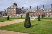 Wide gravel paths, stone steps, rows of yew topiary in formal lawns in front of Royal Hospital