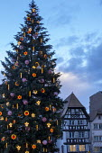 Christmas tree in town square decorated with angels and stars