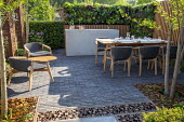 Table and chairs by Patrick Norguet on permeable paving patio, copper kettle and pans on outdoor cooker, outdoor kitchen, living green vertical wall, nasturtiums, Lactuca sativa 'Lollo Rossa', Beta vu...