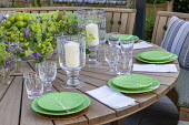 Table and benches by Gaze Burvill laid for dinner, Alchemilla mollis table decoration arrangement