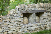 Bee skeps in dry-stone wall alcoves, beehives