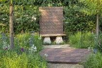 Diagonal brick wall, bench, brick paving, baptisia, achillea, eryngium, hawthorn hedge