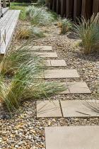 Stepping stone path across gravel, Ammophila arenaria
