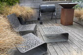 Contemporary bronze chairs by Tom Stuart-Smith on roof terrace, barbecue