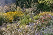 Rudbeckia, Verbena bonariensis, aster, Rosa 'Lady Emma Hamilton', Nepeta racemosa 'Walker's Low', gaura, bird bath in border