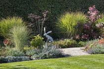 Hare sculpture, Miscanthus sinensis 'Morning Light', Nepeta racemosa 'Walker's Low', cotinus, sambucus, peony, geranium