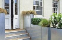 Roof terrace, galvanized zinc containers, Carex comans, Pennisetum alopecuroides 'Hameln'