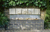 Fountain with stone spirals, galvanized metal and pebbles designed by Sally Price