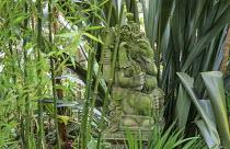 Stone elephant, buddha sculpture, phormium, bamboo