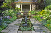 Formal pool, stone pavilion, viburnum