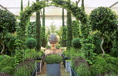 Fountain framed by hornbeam arch, French lavender, spiral-stemmed standard trained bay tree lollipops