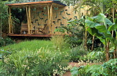Bamboo shelter in exotic jungle garden, timber wall