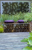 Gabions filled with bottles, recycled bottle water feature, cushions